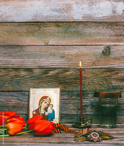 Fotografia  celebration of victory day on may 9, 1945, medals, Orthodox icon and burning red