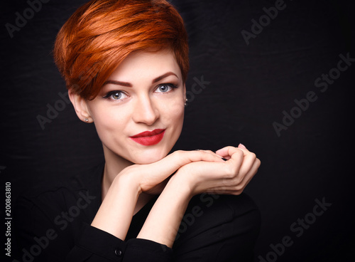 Portrait of a beautiful young red-haired woman with short hair on a dark backgro Canvas Print