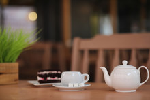 Kettle With A Drink And Dessert In A Street Cafe. Tea In The Ket