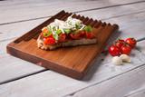 Tasty tomatoes bruschetta - 200875454