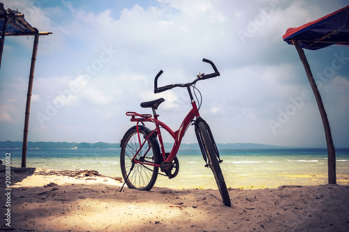 Foto op Plexiglas Red bicycle parked in the beach. Bicycle parking in the beach sand.
