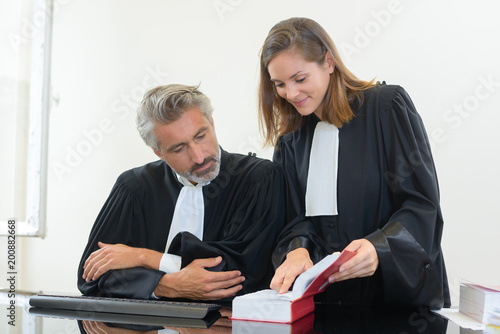 two judges looking at the law book Slika na platnu