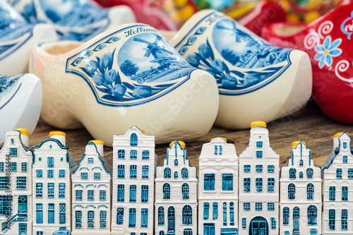 Amsterdam canal houses in front of Dutch colorful clogs
