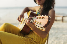 Thailand, Koh Phangan, Woman Playing Guitar At The Beach