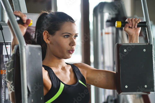 Foto op Canvas Fitness Beautigul fit woman (girl) trains in the gym. Concept: Sport, passion, fitness, love.