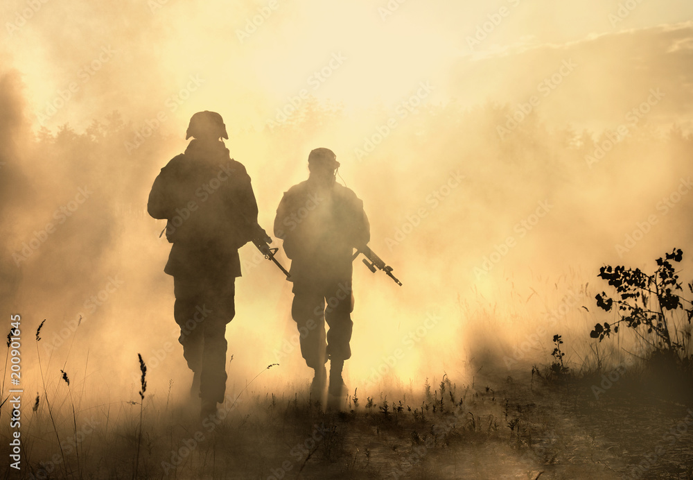 Fototapeta United States Marines in action. Military equipment, army helmet, warpaint, smoked dirty face, tactical gloves. Military action, desert battlefield, smoke grenades