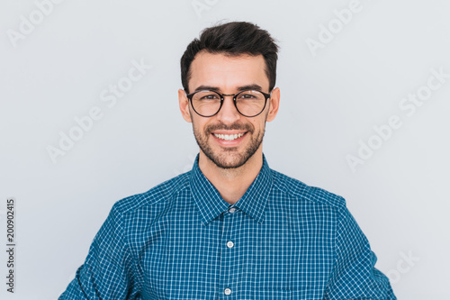 Obraz Closeup portrait of handsome smart-looking smiling with toothy smile male posing for social advertisement, isolated on white background with copy space for your promotional information or content. - fototapety do salonu