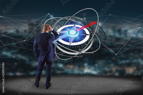 Staande foto Scandinavië Businessman in front of a wall with compass navigation - 3d render