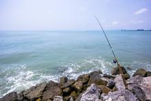 Closeup Fishing On The Sandy B...
