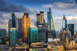 London, England - Panoramic skyline view of Bank and Canary Wharf, central London's leading financial districts with famous skyscrapers and other landmarks at golden hour sunset with blue sky
