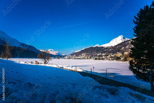 Staande foto Donkerblauw View of a luxury alpine resort town St. Moritz and the frozen lake