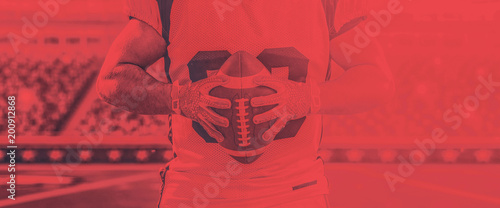 Fotografiet  closeup American Football Player isolated on big modern stadium
