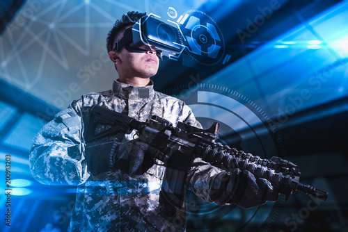 Cuadros en Lienzo The abstract image of the soldier use a VR glasses for combat simulation training overlay with the hologram