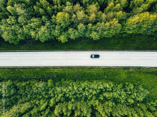 Poster Luchtfoto Aerial view of green summer forest with a road.