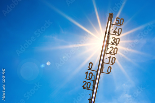 Vászonkép  Summer background, bright sun with thermometer