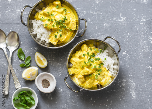 Obraz Salmon curry and rice in curry dishes on grey background, top view. Indian cusine style. Flat lay - fototapety do salonu