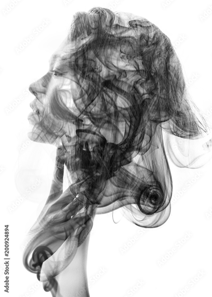 Fototapeta Double exposure profile portrait of a young sexy woman with pouty lips and a smoky texture dissolving into her facial features and hair