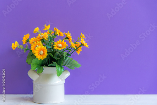 Purple Wall With Yellow Flower On Shelf White Wood Copy Space For