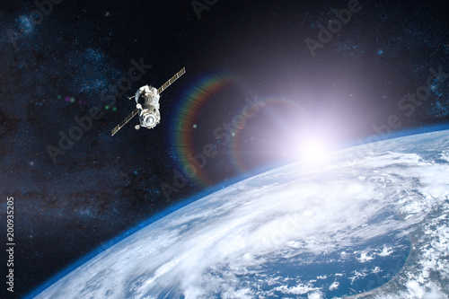 Blue planet Earth. Spacecraft launch into space. Elements of this image furnished by NASA.