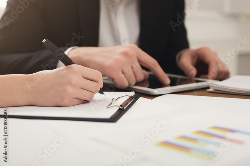 Fototapety, obrazy: Business colleagues using tablet and working with documents