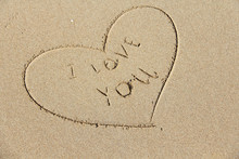 The Inscription On The Sand I Love You. The Heart Is Painted On The Sand. Design With Copy Space. Top View
