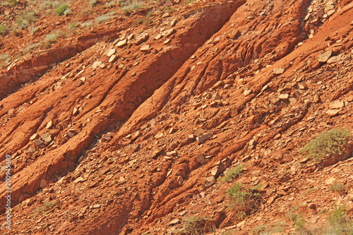 Papiers peints Orange eclat Beautiful mountains of red clay against the blue sky. Landscape of the desert. Space for text. dramatic landscape of the clay desert