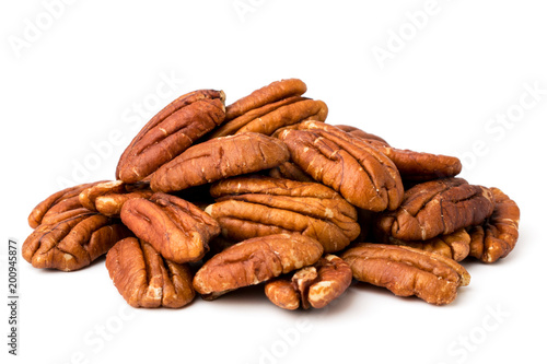 fototapeta na lodówkę A bunch of peeled pecans on a white, isolated.