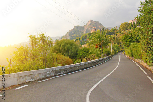 Deurstickers Honing Beautiful Winding and Picturesque Green Road in the City of Taormina. The island of Sicily, Italy