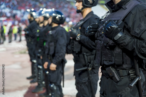 Fototapeta Special police unit at the stadium event secure a safe match