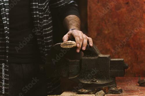 Valokuva  Man works in carpentry workshop