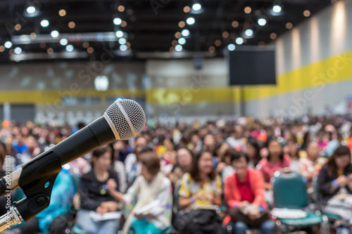 Microphone over the Abstract blurred photo of conference hall or seminar room in Wallpaper Mural