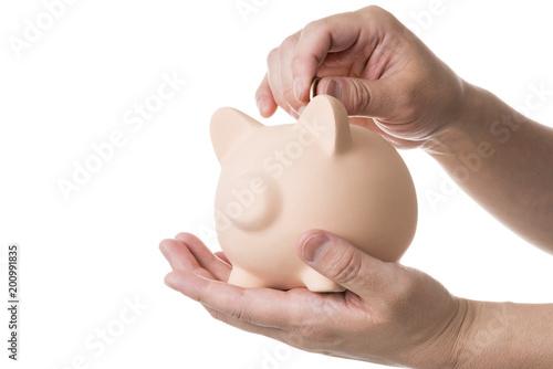 Fototapeta 貯金箱をお金を入れる obraz