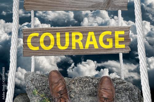 Fotografie, Obraz  Challenging bridge with text Courage