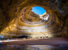 Famous Sea Cave At Benagil Beach In Algarve, Portugal