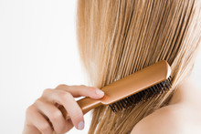 Young Woman With Comb Brushing...