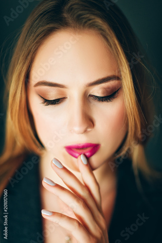 Young beautiful woman studio shot, pretty girl with professional make up , dark Poster