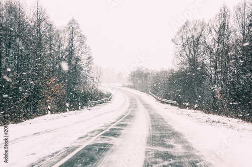 Snow-covered Open Road During A Winter Snowstorm. Adverse Weather Canvas Print