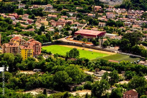 Foto op Plexiglas Stadion Green field of the stadium among the city in Kotor