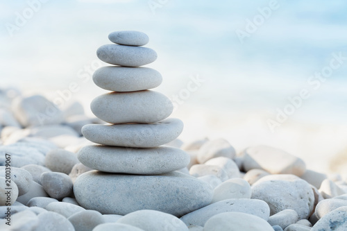 Fotobehang Zen Stack of white pebbles stone against sea background for spa, balance, meditation and zen theme.