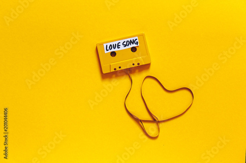 Retro Audio Tape With The Inscription Love Song On A Yellow Background, Top View. Romance Concept - 201044406