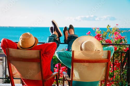 Deurstickers Ontspanning happy couple relax on balcony terrace