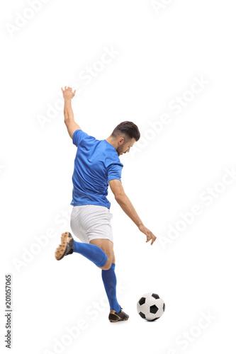 Obraz na płótnie Soccer player kicking a football