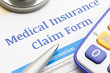 Medical insurance claim form, Stethoscope, pen and calculator symbol for health care costs or medical insurance