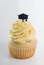 Graduation Theme Vanilla Cupcake On White Background