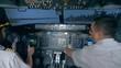 Pilots control in a flight simulator.
