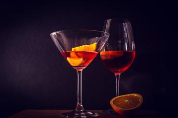 FototapetaFresh coctail with orange and alcohol. Dark background
