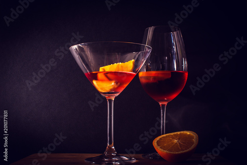 Photo  Fresh coctail with orange and alcohol. Dark background