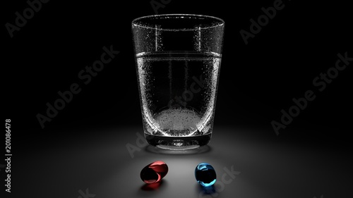 Two red and blue drug gel capsules and a glass of cold water with condensation d Fototapeta