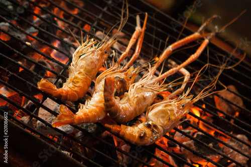 Grilled prawns sold at a street food market stall Poster