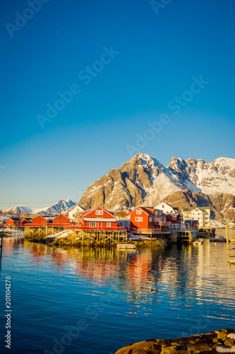 View of many wooden houses in the shore of Henningsvaer in Lofoten islands